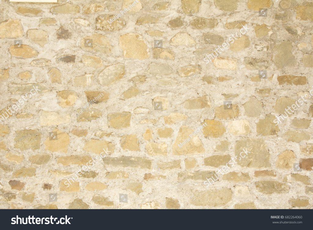 Mollie Pritchett Shutterstock Image of Tuscan stone wall.